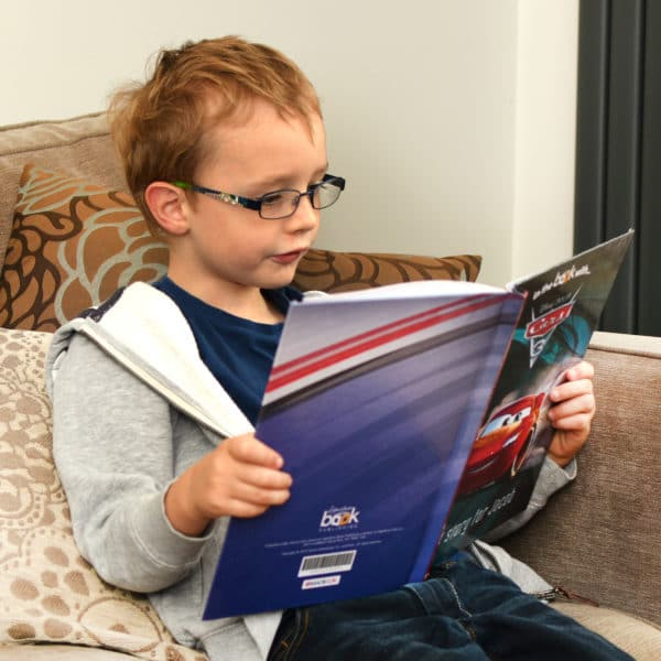 child reading cars book